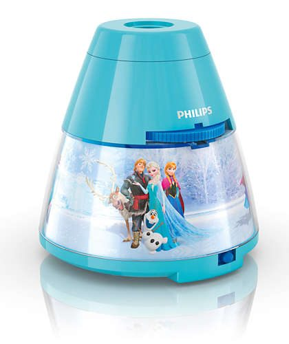 Proyector Frozen ,esta lámpara de Philips para el dormitorio de tus hijos crea un ambiente que hace que los niños se dejen llevar por aquello de lo que más disfrutan: ¡diversión y creatividad!. Una lámpara de sobremesa fabricada con material sintético y que es,totalmente segura para los niños. Sirve como luz de noche y también proyecta diapositivas en el techo de los personajes de la película Frozen de Disney, se proporcionan con el producto 3 discos con 8 diapositivas cada uno,incorpora un interruptor con las funciones : luz de noche / apagado/ proyector , para que puedas elegir fácilmente. La tecnología Led integrada en esta lámpara de iluminación, es una solución desarrollada en exclusiva por Philips. Permite disfrutar de un flujo luminoso óptimo y correcto, el consumo del led es de 0,3 watios Proyector Frozen funciona con 3 pilas AA ( no van incluidas en el producto) lo cual lo hace perfectamente seguro para los niños, ya que no se conecta a la corriente. Sus medidas son , 11,5 centímetros de diámetro y 11,8 centímetros de alto Buscas el colgante Frozen? Clika aqui