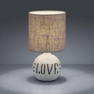 """Sobremesa modelo Esna ,esta lámpara de Trio es ideal para casi cualquier rincón de nuestro hogar,perfecta para cualquier dormitorio, ya que podemos colocar cada una en una mesita de noche o, poner una sola si es un dormitorio juvenil, en la entrada de casa o en cualquier buffet, pudiendo colocar una o los dos modelos, todo depende de ti!! Sobremesa modelo Esna, es un modelo con diseño vintage, fabricado en cerámica y pantalla de tela, llevan escritos las palabras """"LOVE"""" y """"HOME"""", para que puedas escoger la que mas te guste. Sus medidas son , 16,5 centímetros de diámetro y 31 de altura,el cable de conexion mide 150 centímetros y el portalámparas es de rosca E-14, adjunto una foto de las medidas exactas del sobremesa. Se suministra con bombilla de led de 7 watios en luz 3000K, para que no tengas que comprar nada mas!!"""